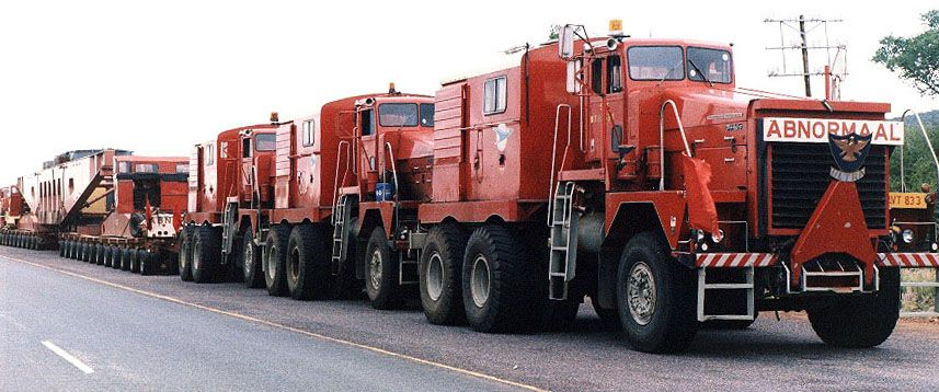 3 ABNORMAL company mules hooked together pulling a