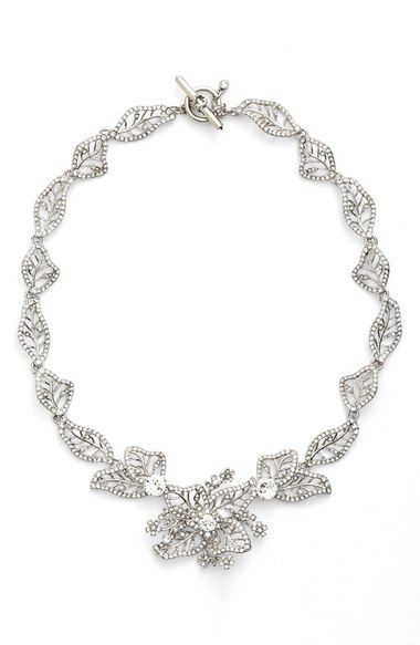 Marchesa Crystal Leaf Collar Necklace available at #Nordstrom | A wreath of beautifully tooled leaves fans out from the crystal-studded blossom at the center of this regal collar necklace.