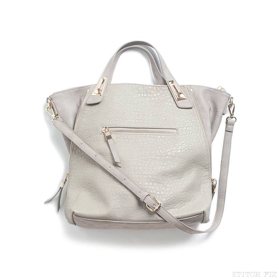 LOVE this bag...maybe a different color with silver hardware : )