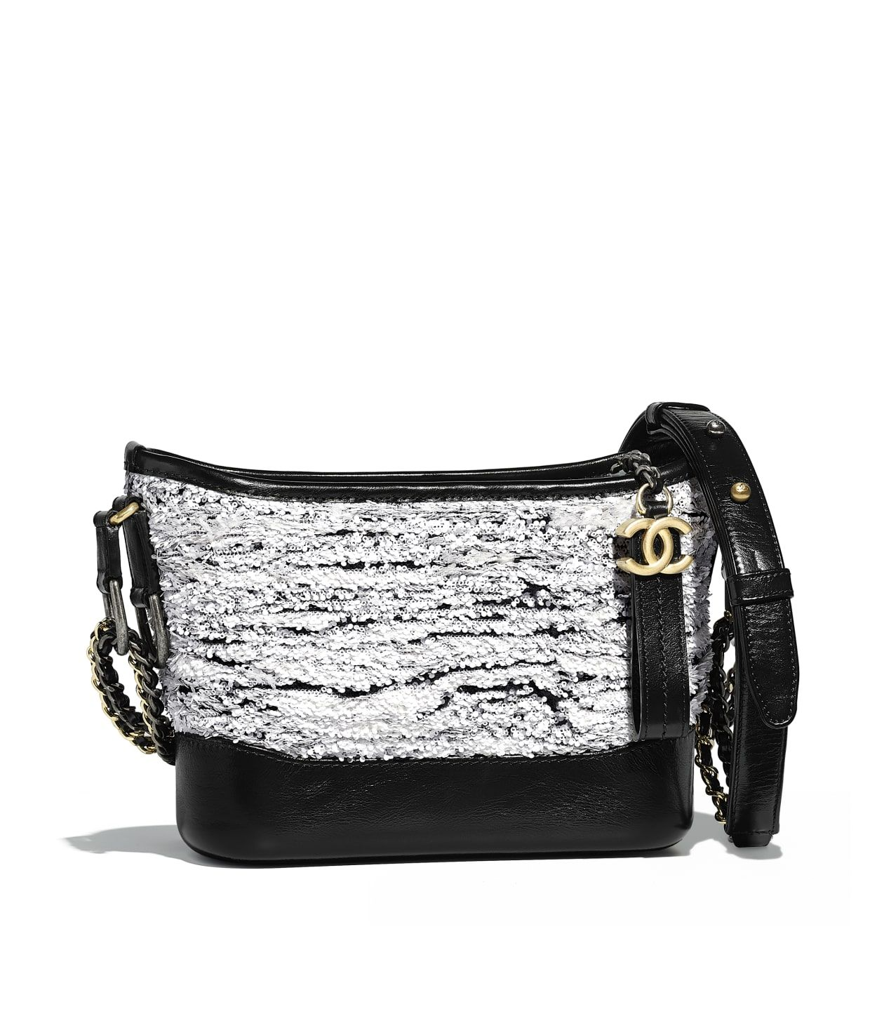 14ee319af38016 Discover the CHANEL Sequins, Wool, Calfskin, Silver-Tone & Gold-Tone Metal  White & Black CHANEL'S GABRIELLE Small Hobo Bag, and explore the artistry  and ...