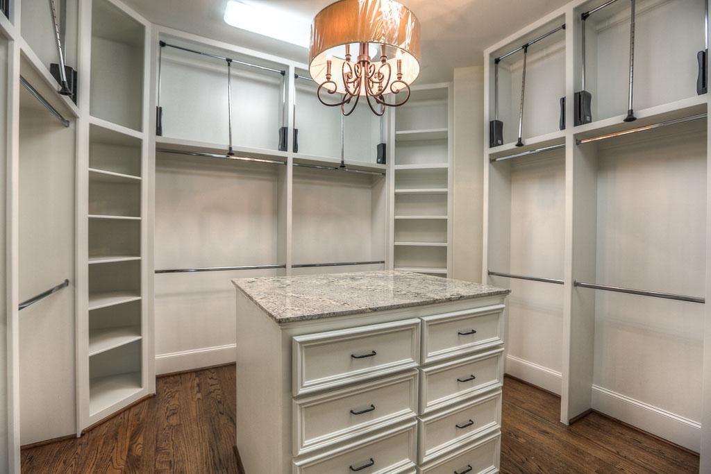 Master Bedroom Closet Has A Designer Light Fixture