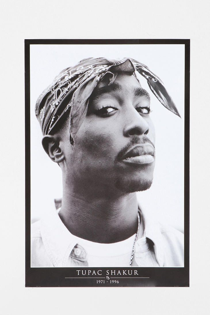 One of my posters before I found some of the pins of my dreams. (Tupac is looking finer than ever but he has a look in his eyes like he doesn't like the photographer. )