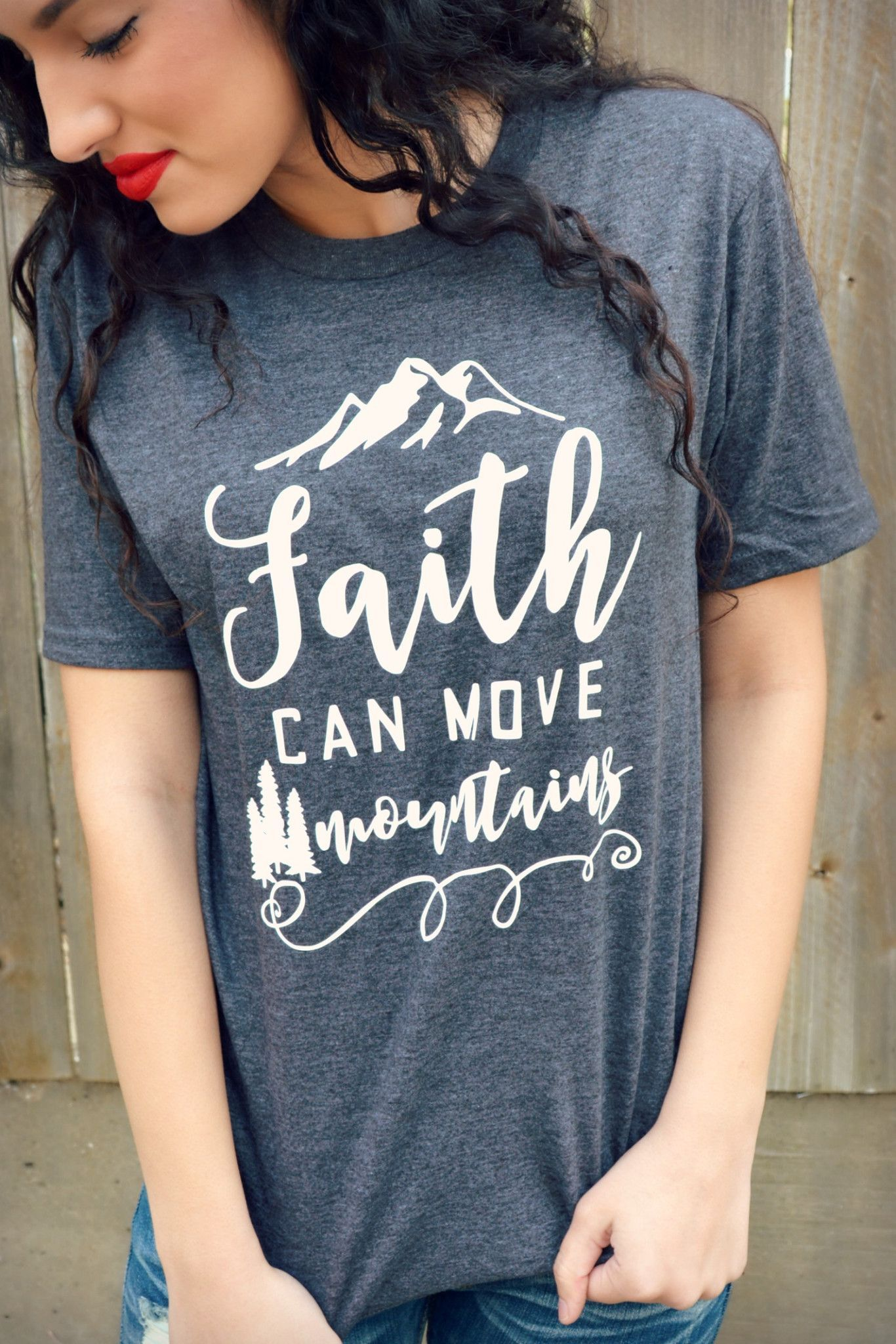"""Our Faith Can Move Mountains Tee is a LaRue Exclusive and features a super soft heather charcoal gray tee with the phrase """"Faith Can Move Mountains"""" in white. Made of 50% Cotton and 50% Polyester. Mod"""