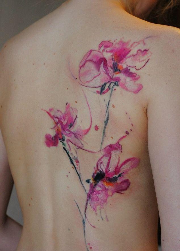 Pink flower back tattoo