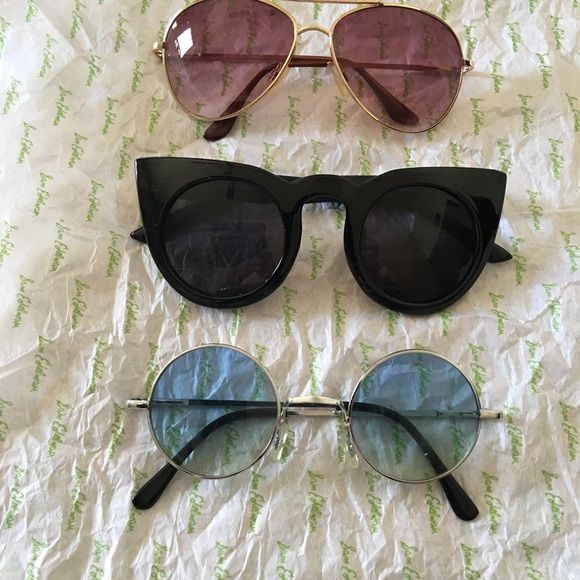 Sunglasses Three pairs of sunglasses.  Gold aviators have a small nick on frame above right eye. Accessories Sunglasses