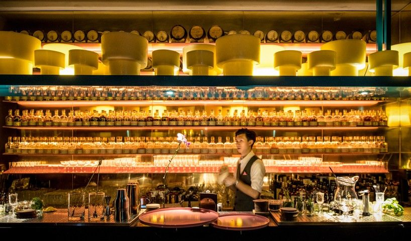 the bar unveils a large display of selected vintage glassware paired with unexpected elements.