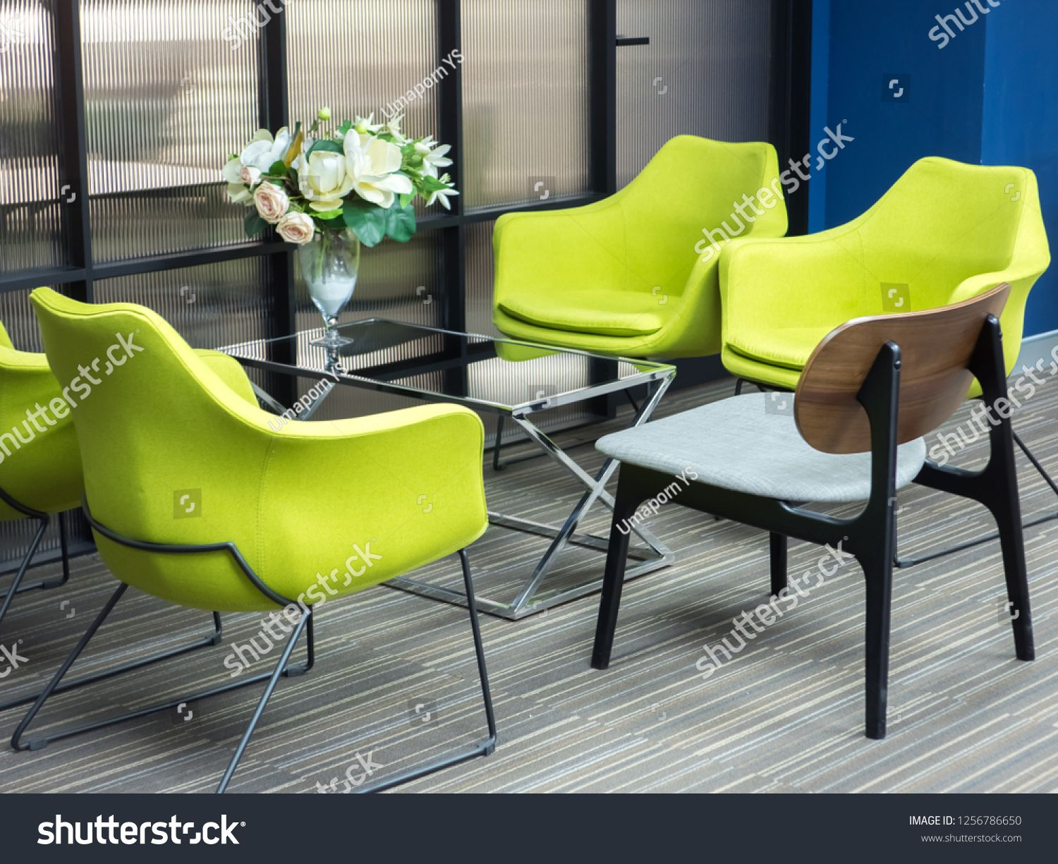 green chairs with glass table in office meeting room.glass#chairs