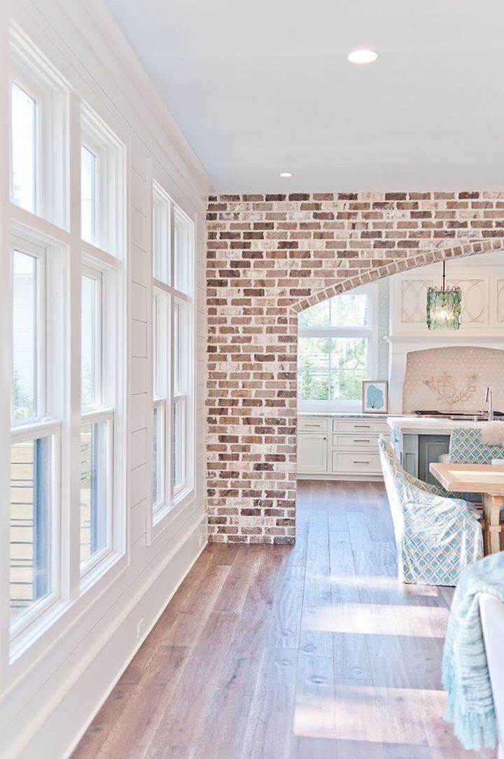 Love the light wood flooring and the exposed brick wall - Brick and wood house ...