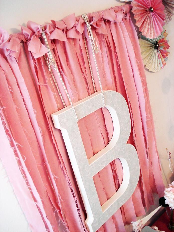 Cute backdrop idea Ribbon or fabric an initial Vintage Chic 1st