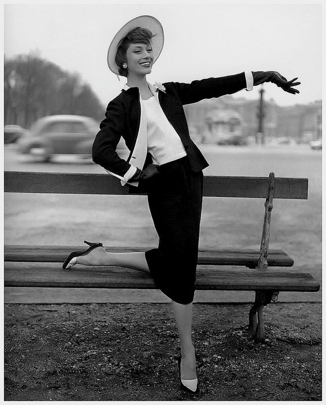 Elegant black shantung and white piqué suit by Chanel, February 1957