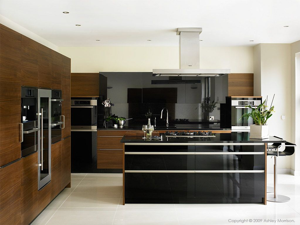 Black Gloss And Walnut Kitchen By Robinson Interiors In A Home Near The County Down Town Of C Modern Walnut Kitchen Kitchen Cabinets And Granite Walnut Kitchen