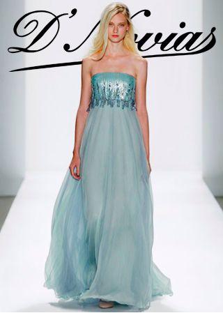 Moderno vestido con falda en chifon de seda y en la parte superior detalle de chaquerias con anillas.