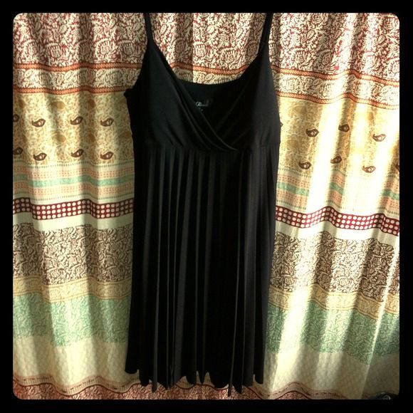 Black spaghetti strap pleated Empire waist dress Black spaghetti strap pleated Empire waist dress. New with tags! Never worn! In my closet for few years as a back up!  Beautiful dress! Nice item to closet! Dresses