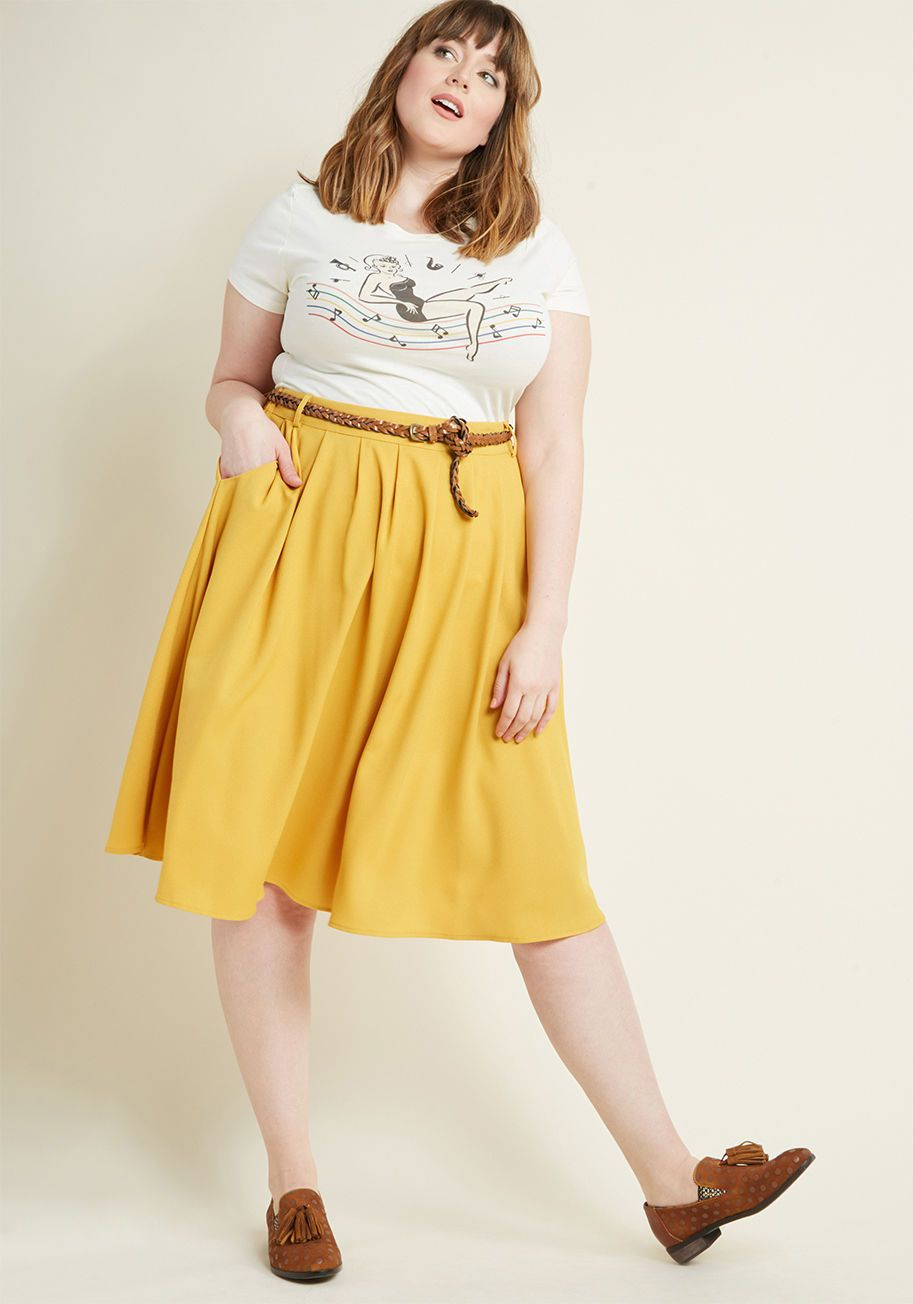 560fd4abcf Match the beauty of your favorite flower petals by opting to flaunt this  mustard midi skirt for the day! Clasp the braided faux-leather belt through  the.