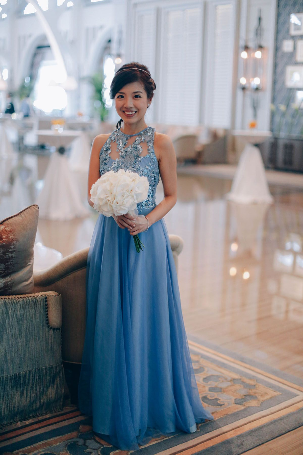 Bride in powder blue wedding gown and classic, round bridal bouquet ...