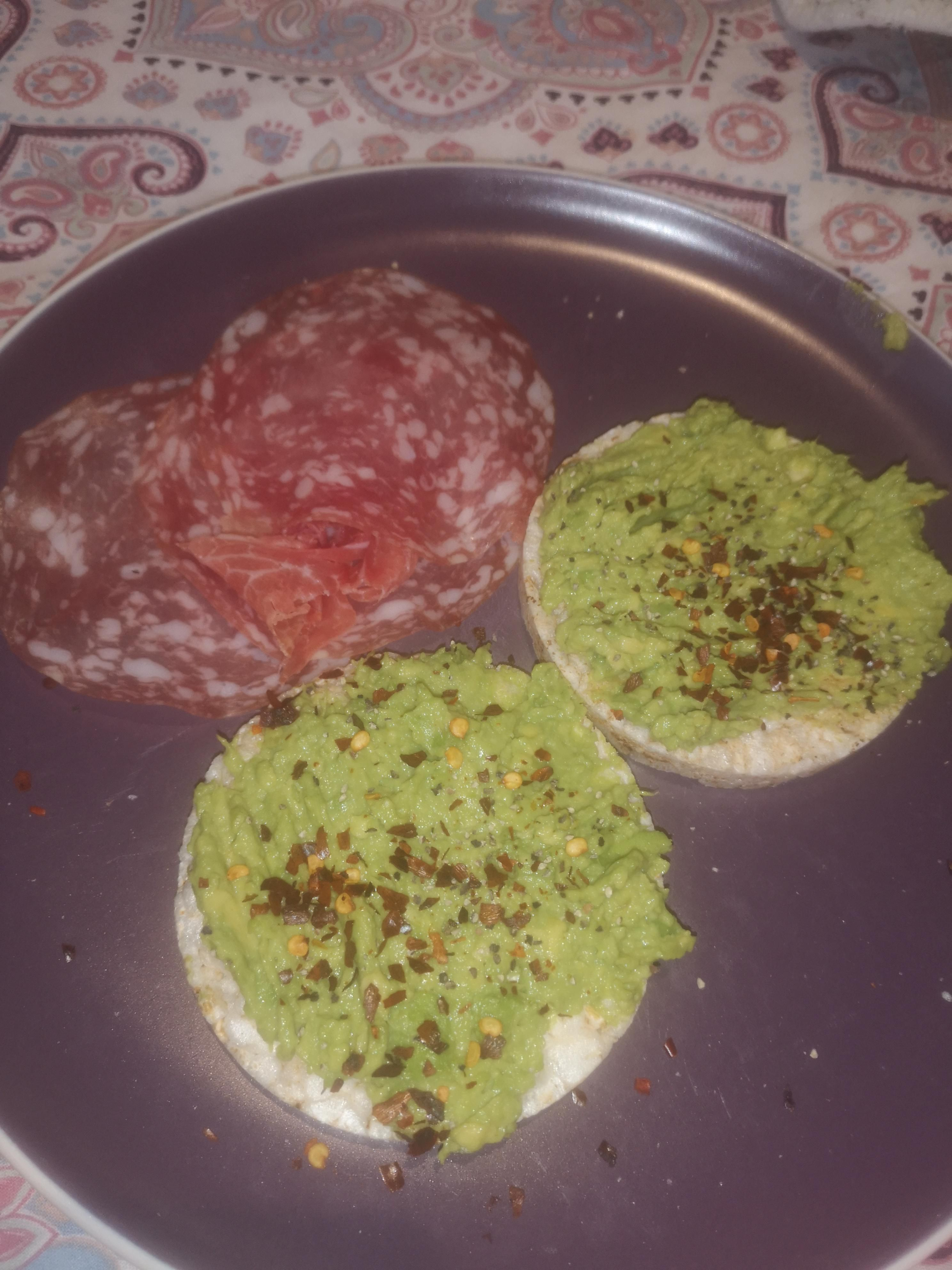 Avocado on rice cakes with a couple of slices of salami