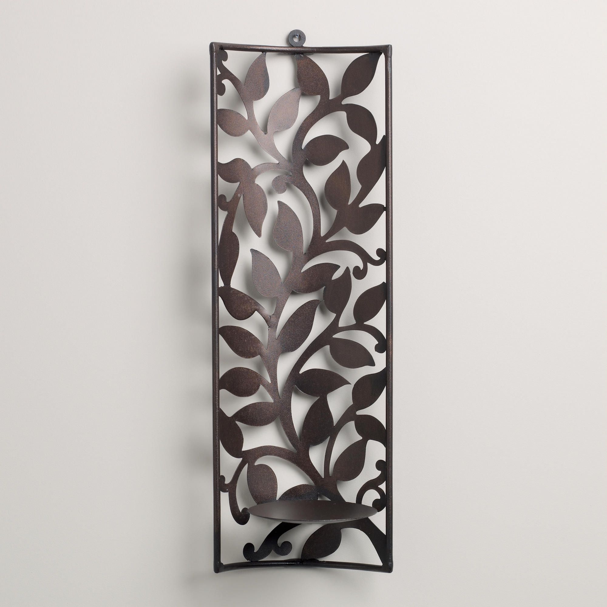 """2 of these with bluish/green candles flanking a smaller piece of art over headboard Sconce with Leaf Cutout 