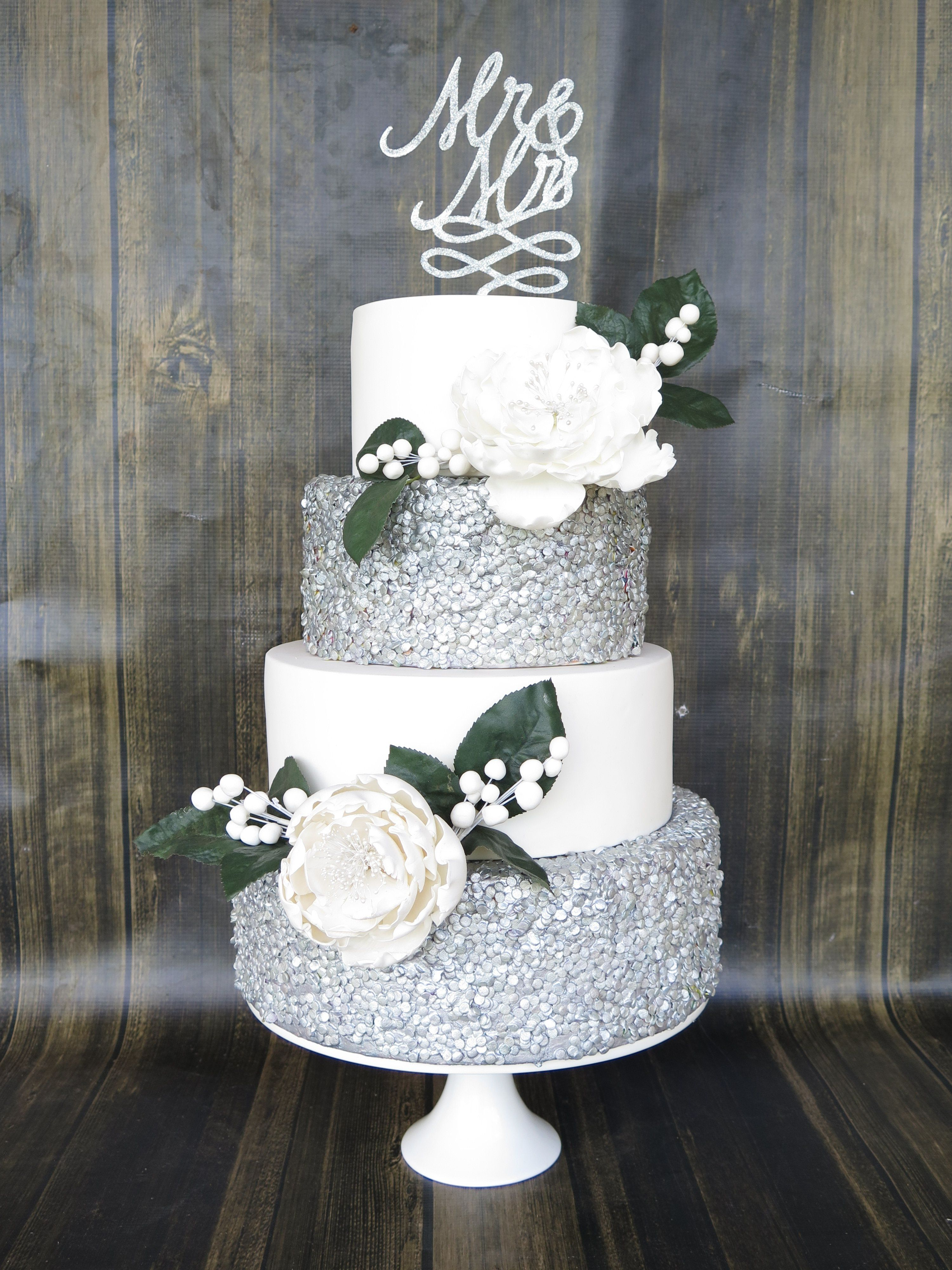 4 tier wedding cake silver edible confettisequins larege fondant flowers sparkly
