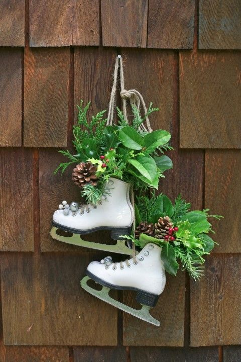 Vintage Skates as Festive Decor - if you have some old skates lying around the basement gathering dust, do this! Put those babies back into use as charming holiday décor for your door. I love how they did it, so simple!