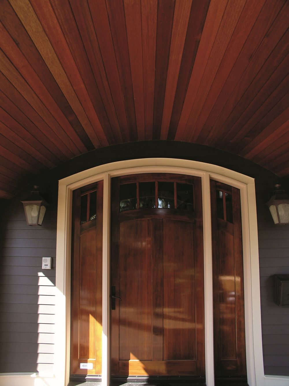 Dark Red Meranti Tongue And Groove Soffit Provides A Beautiful Entrance Wood Supplied By Kayu Canada Inc Wood Supply Wood House Exterior