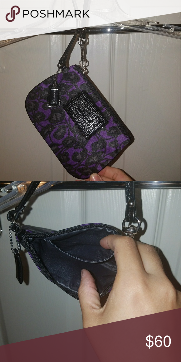 Coach poppy wristlet Purple and black coach poppy wristlet.brand new. Never used. Coach Bags Clutches & Wristlets