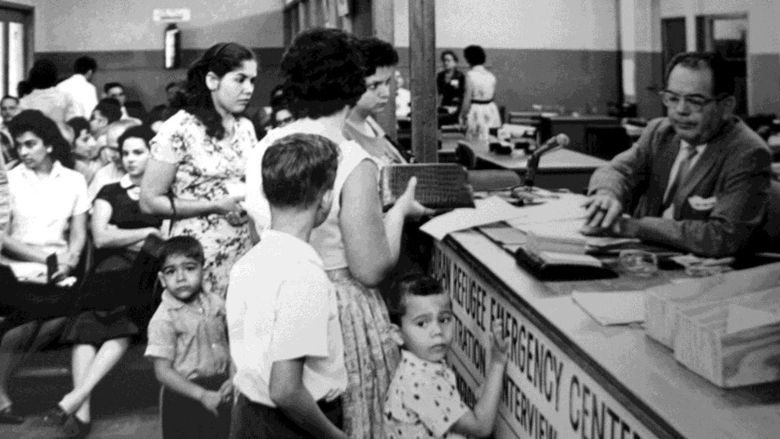 Freedom Flights Cuban refugees crowd into a processing area at the Freedom  Tower in 1967 | The freedom tower, Cuban, Fidel castro