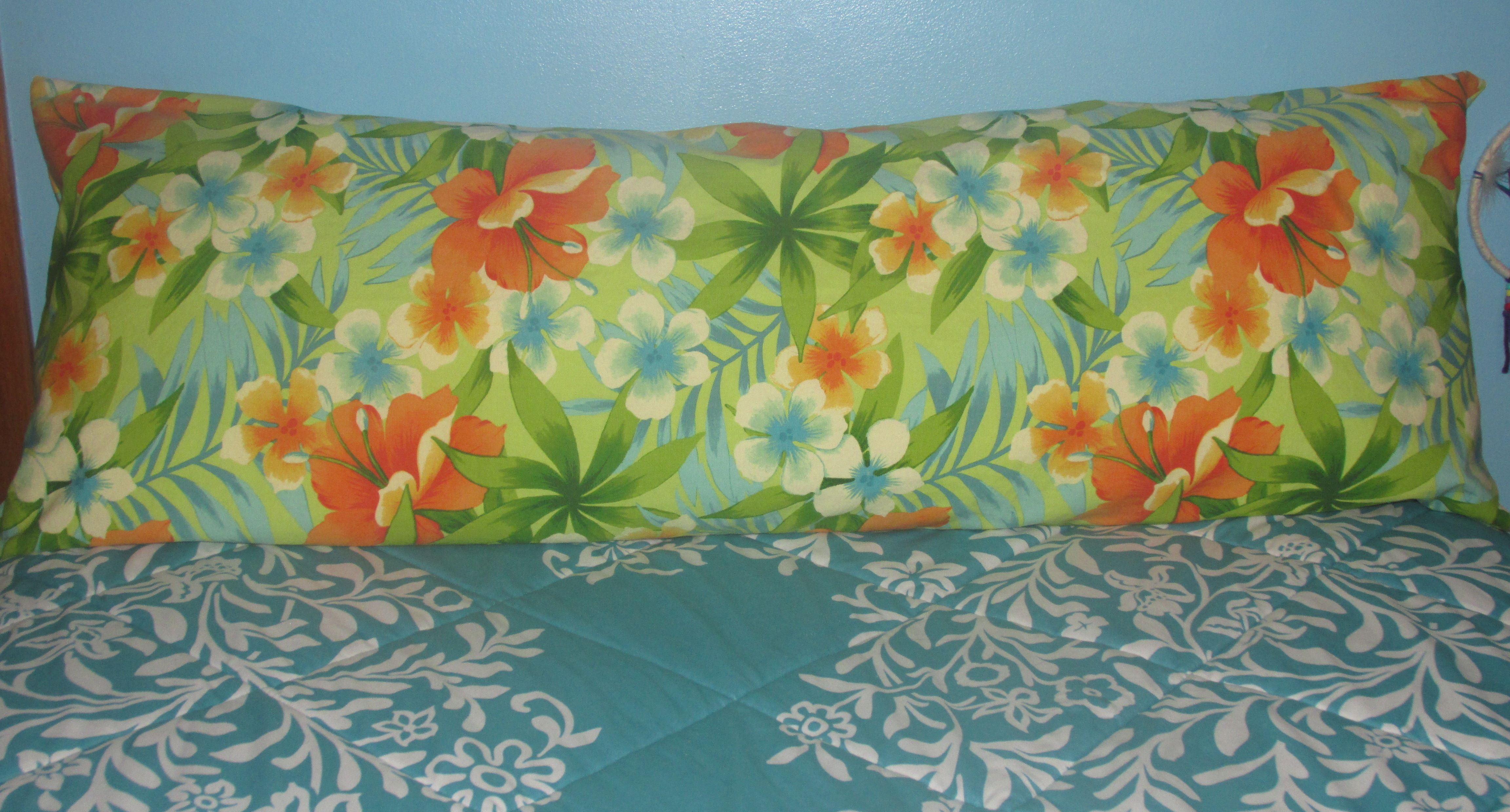 This custom ordered body pillow cover is made of a Hawaiian print canvas fabric with a zipper on the reverse side.
