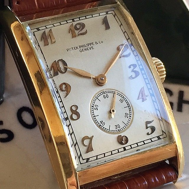Patek Philippe 18k Yellow Gold Tank Circa late 1930's. Formed to fit the wrist 42mm case.