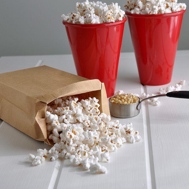 Popcorn in a brown bag! 1/4 cup kernels, paper bag, 3 minutes in microwave!