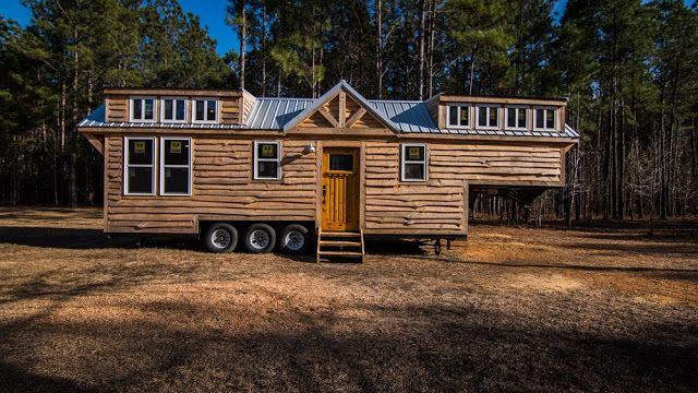 a rustic tiny house built onto a 39 39 gooseneck trailer with two bedrooms a full kitchen and a. Black Bedroom Furniture Sets. Home Design Ideas
