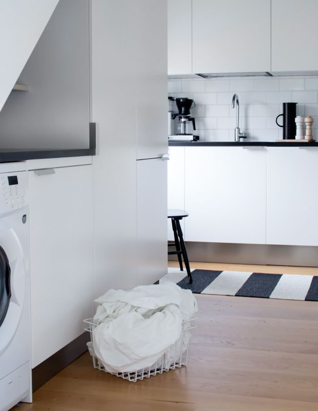 The petite laundry area is tucked into the kitchen, making washing tea towels as easy as can be