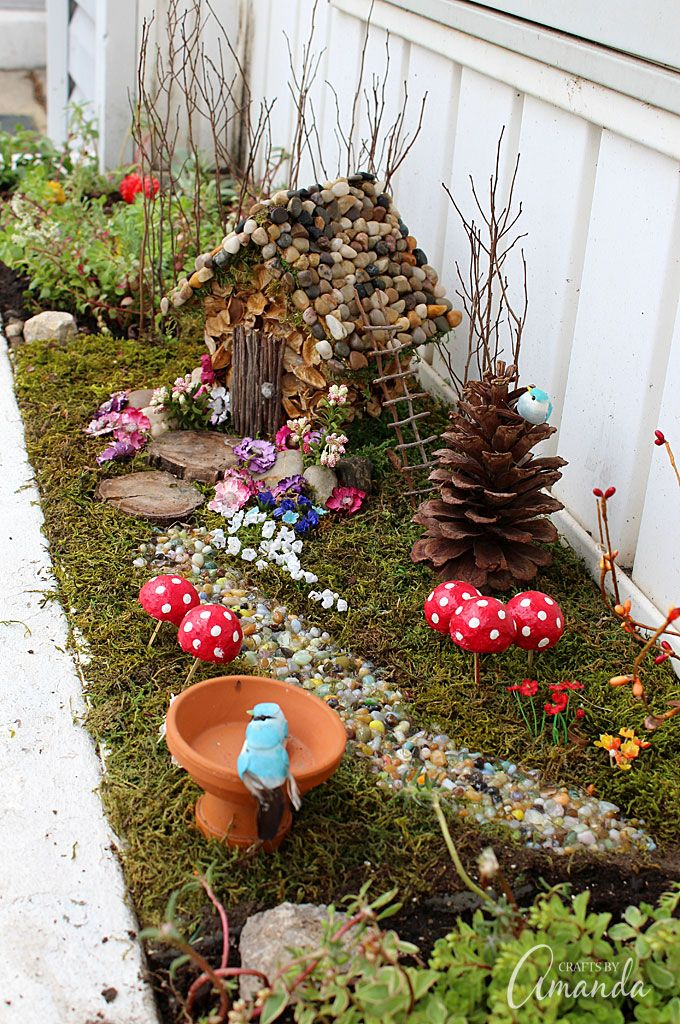 Turn an ordinary $1.00 wooden birdhouse into an adorable fairy house nestled in a moss covered outdoor fairy garden!