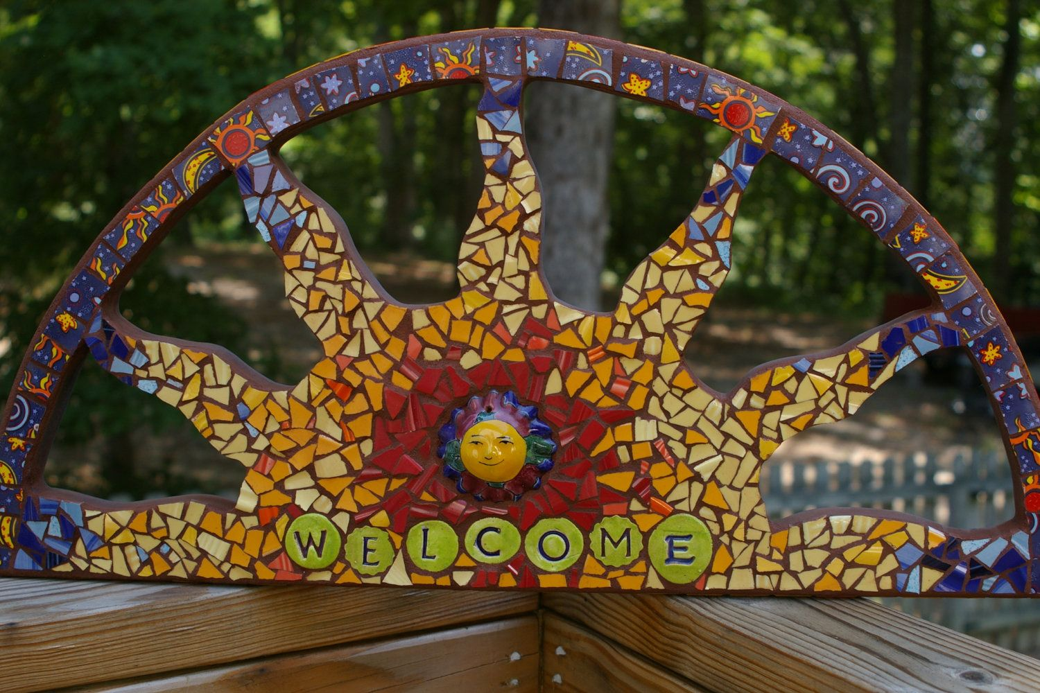 Welcome sun mosaic artwork over door or entrance welcome sign