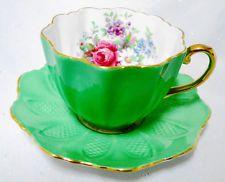 PARAGON ROSE DAISY GREEN GOLD TEXTURE TEA CUP AND SAUCER