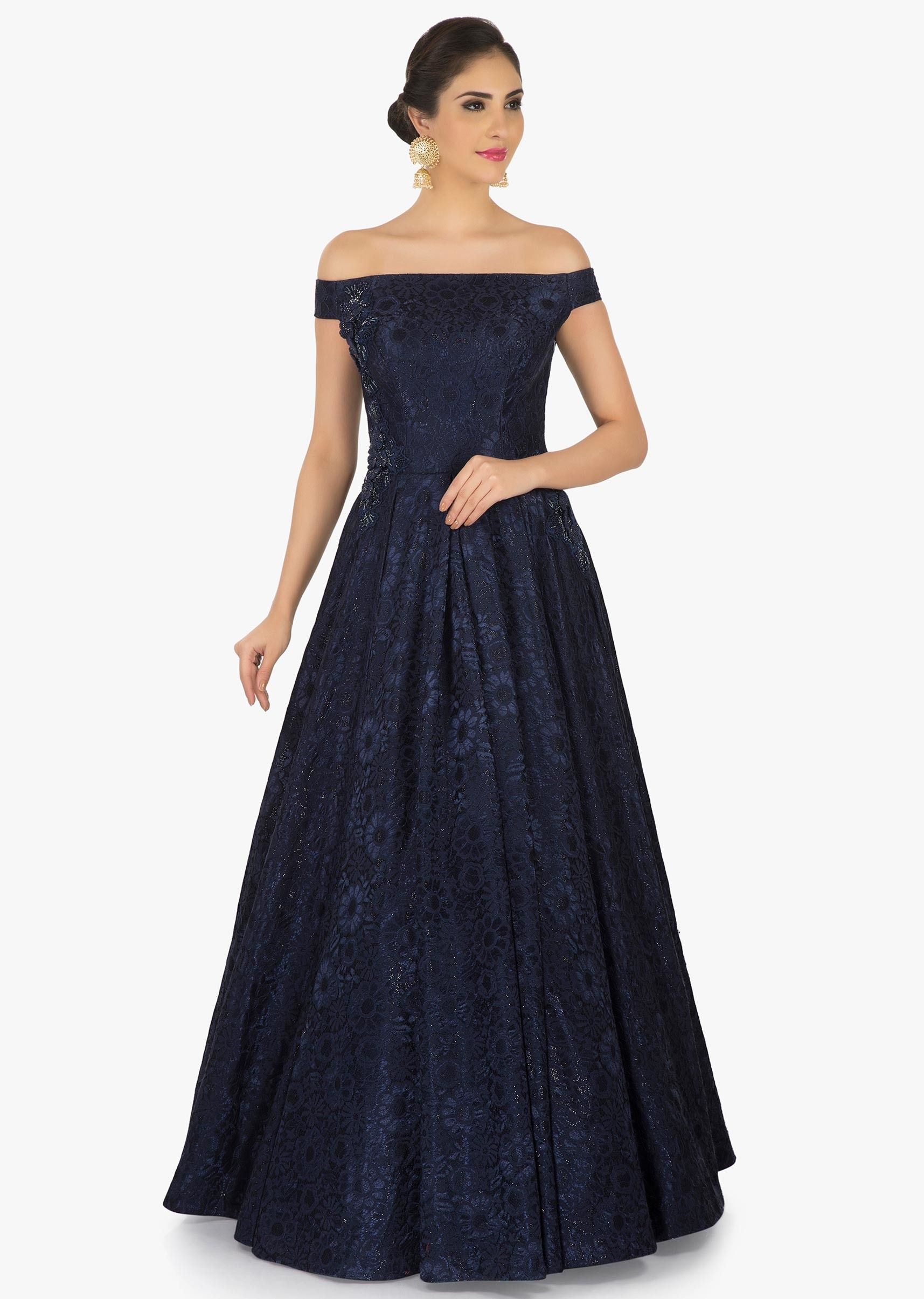 0635c0affc2d The navy blue gown is featured in chantilly lace fabric. Showing its all  prime importance the gown is displays the unusual embroidery work in moti.