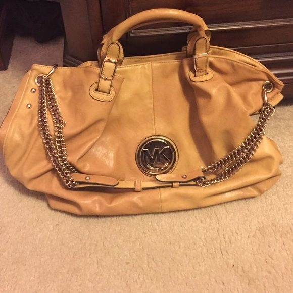 "Purse ""Michael Kors"" purse. Used a few times. More of a camel color Bags Shoulder Bags"