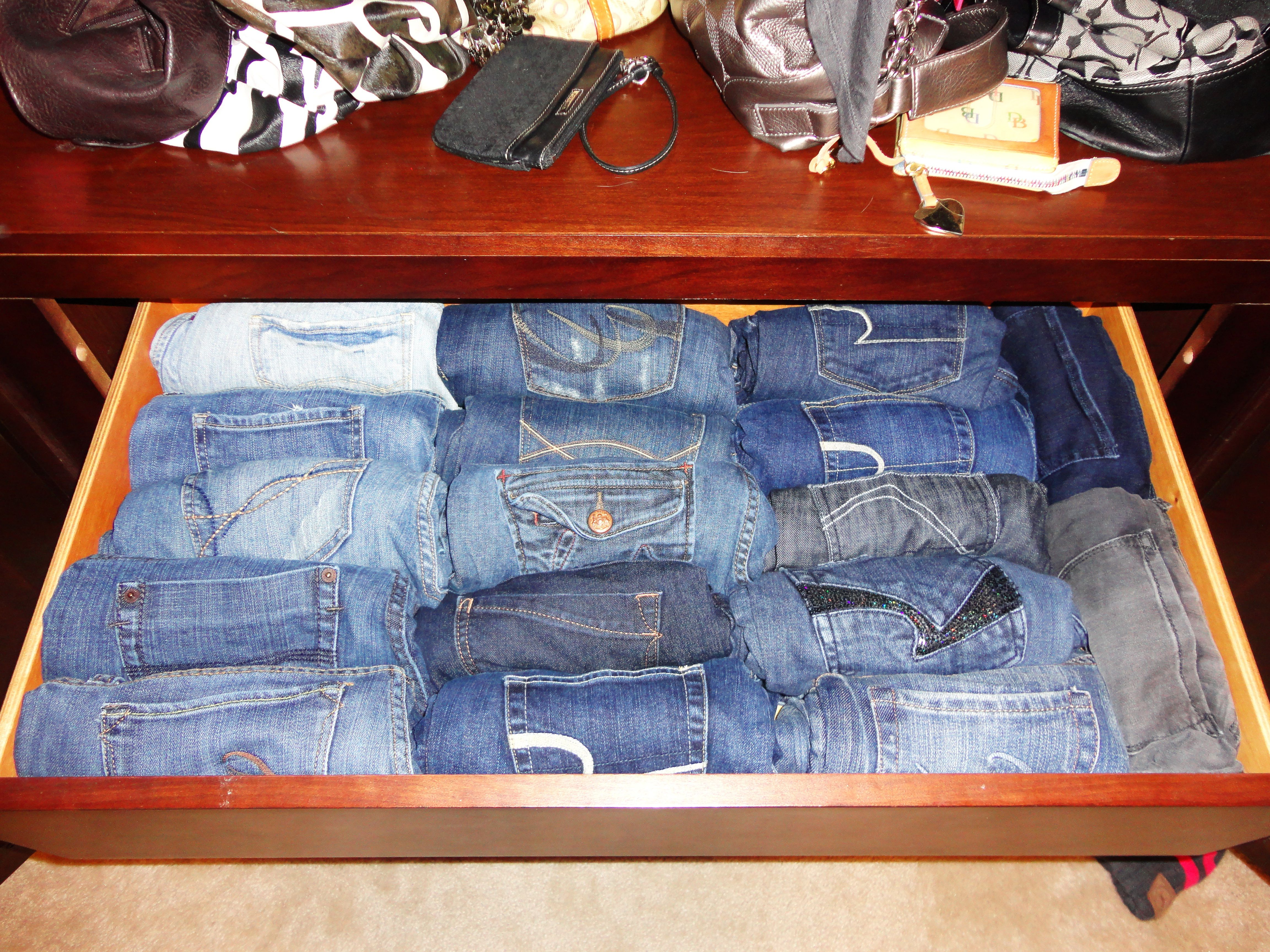 Organize Your Jeans Roll Them And Place Them In A