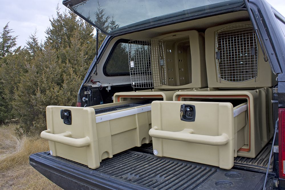 Vault & Kennel System in the back of a truck with cover