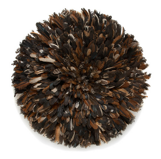 African Luxe The Juju feather headdress or Bamileke hat works beautifully as three dimensional wall art adding a textural pop of color, bringing your room to life.