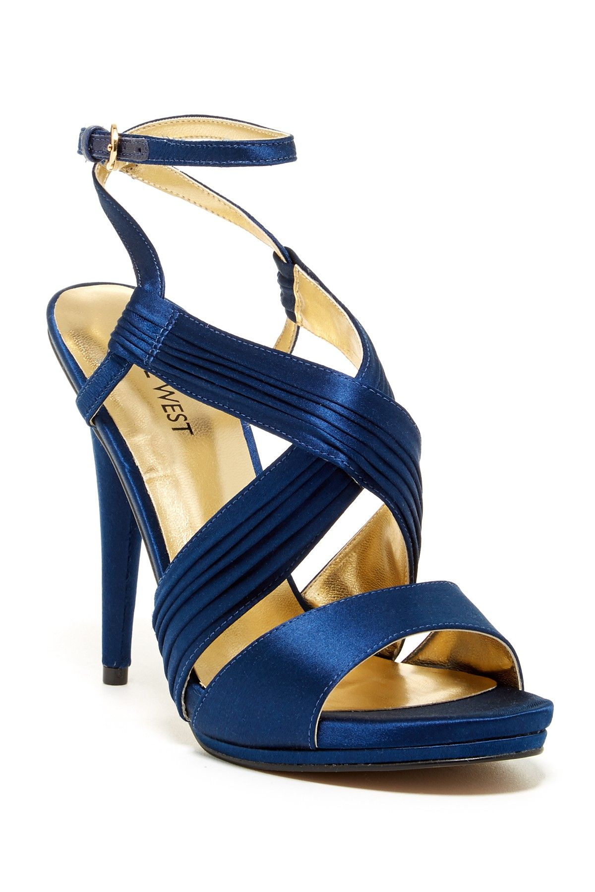 Crisscross vamp with pleated detail  - Adjustable ankle buckle strap closure
