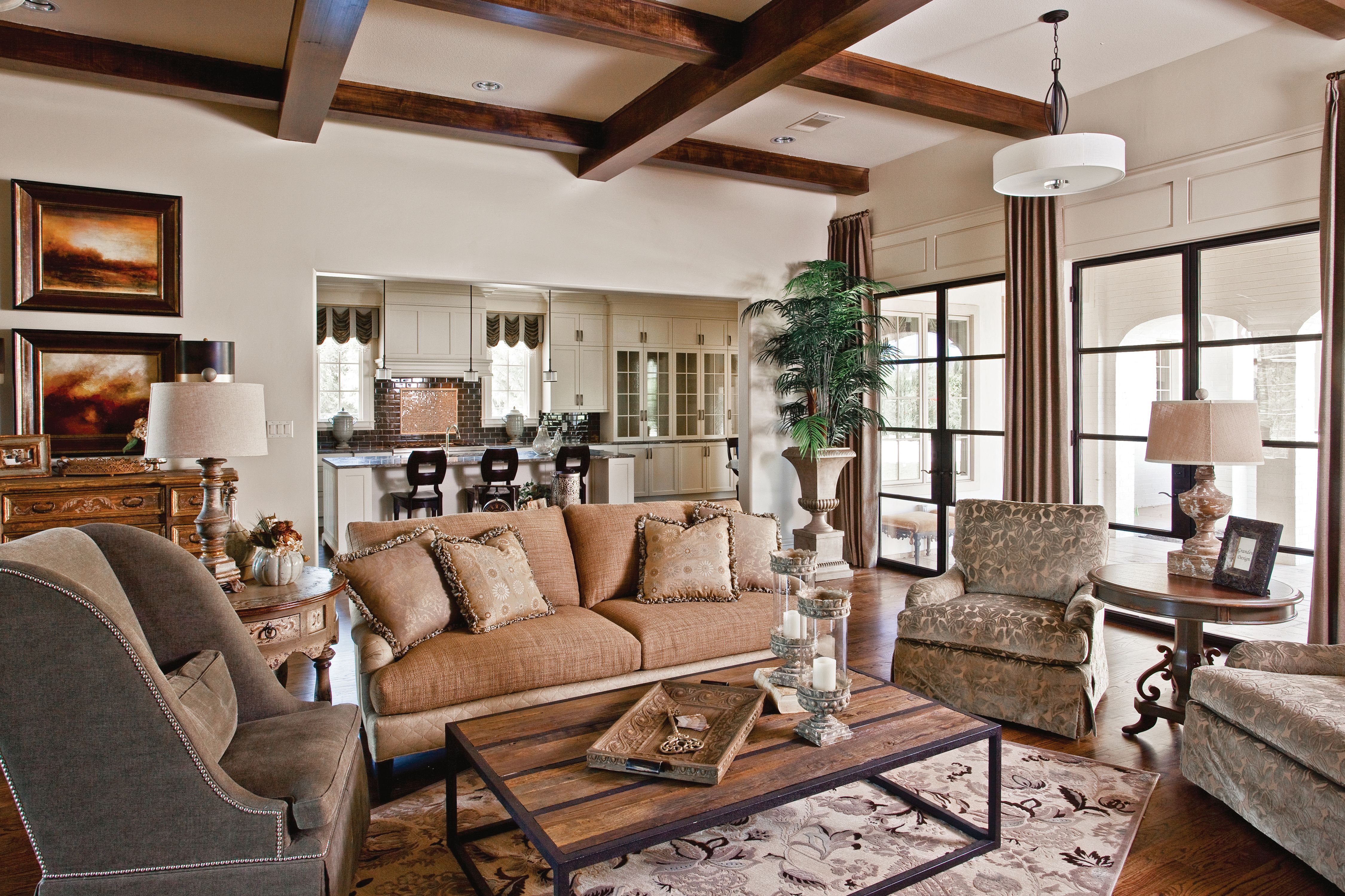 Grandeur Design Custom Living Room Featuring Fabrics And Pieces