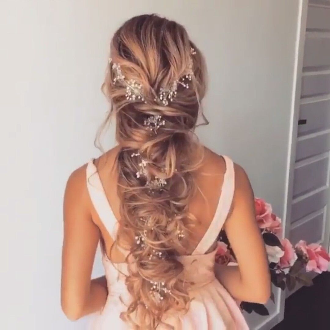 wedding hair!! flowers braided into hair. then pulled for a