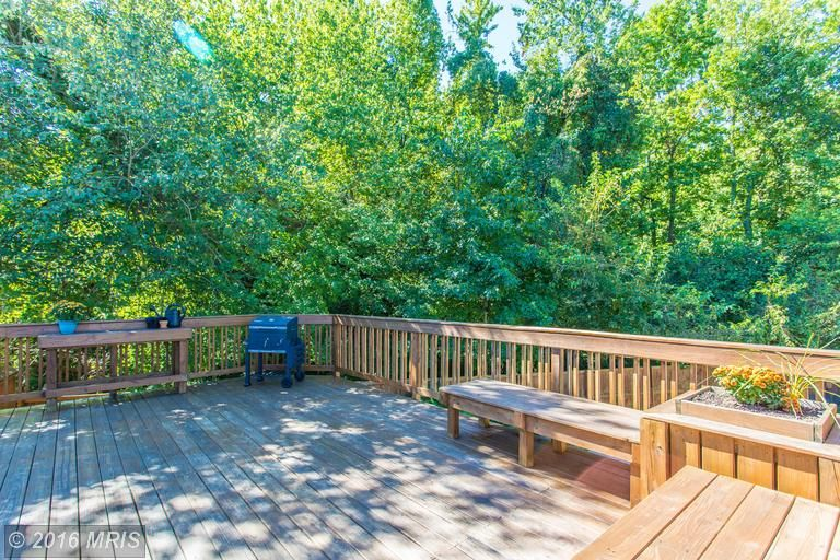 Large multi-level deck in backyard overlooking pool, fire pit, fountain and surrounded by wooded lot. Contact me today for a private showing! www.michelle.jimbassgroup.com 301-606-3703