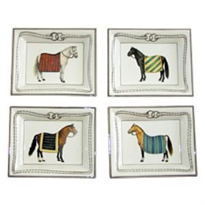 This set of four small change trays is very practical as a serving accessory. Grouped together, the trays make a beautiful wall arrangement, also.  Product in photo is from www.wellappointedhouse.com