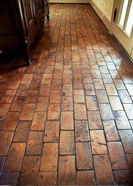 This Floor Is Made From The End Pieces Of Two By Fours Not Sure Who Is Going To Flooring Brick Flooring Brick