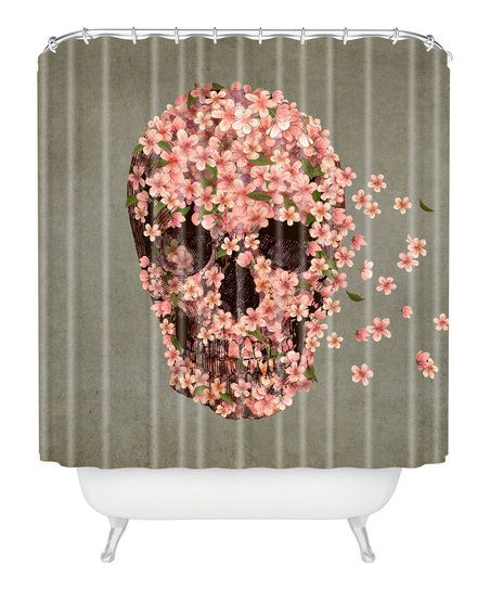 This vivacious shower curtain brings a dash of color and style to any understated bathroom.