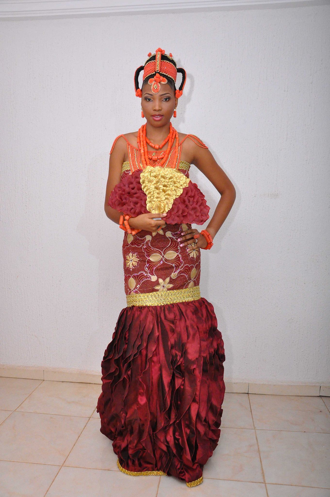 My cousin amaka in traditional bridal wear coral beads and fan