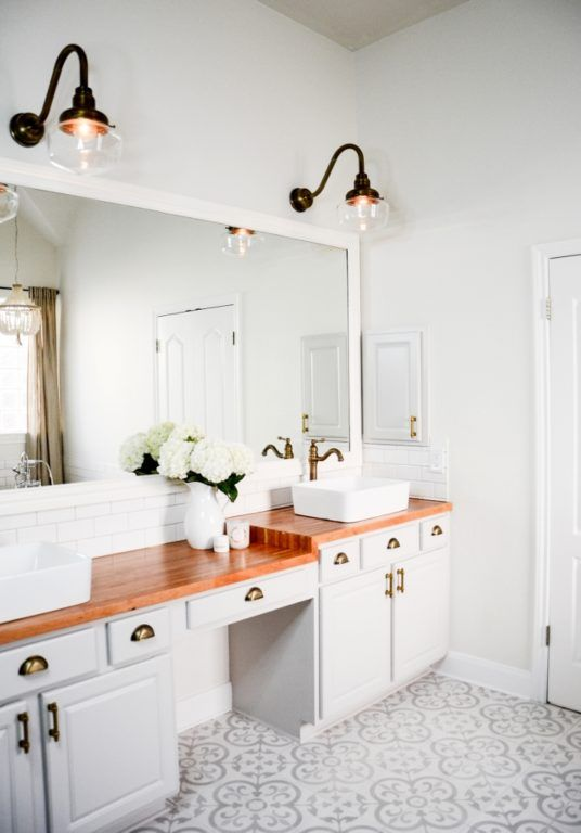 Brass Schoolhouse Lighting Offers A Glamorous Style To This Bathroom!