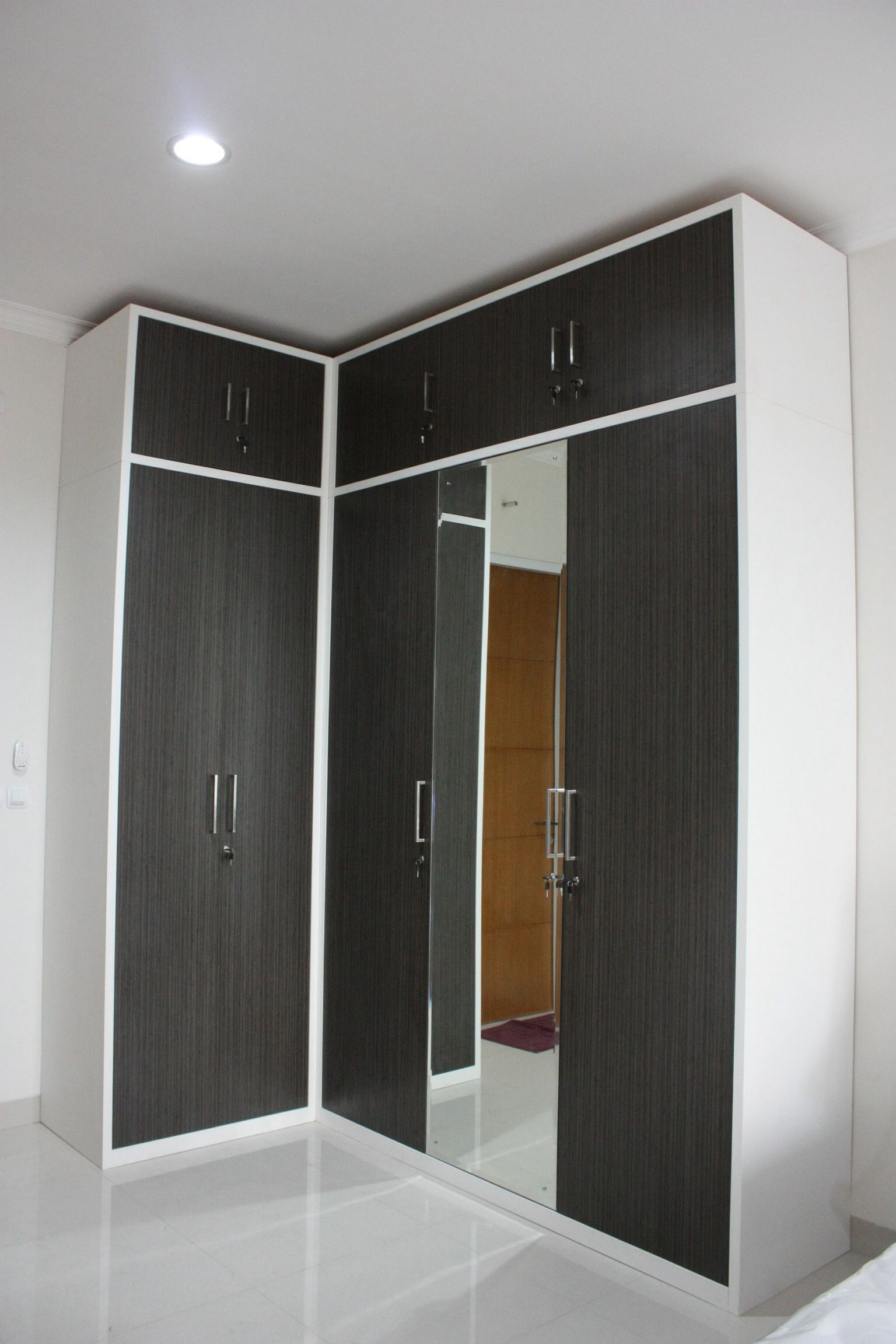 Customized l shaped wardrobe in japanese bamboo hpl finish for L shaped bedroom cupboards
