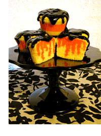 Halloween cupcakes--yellow poke cake with orange jello and chocolate icing!